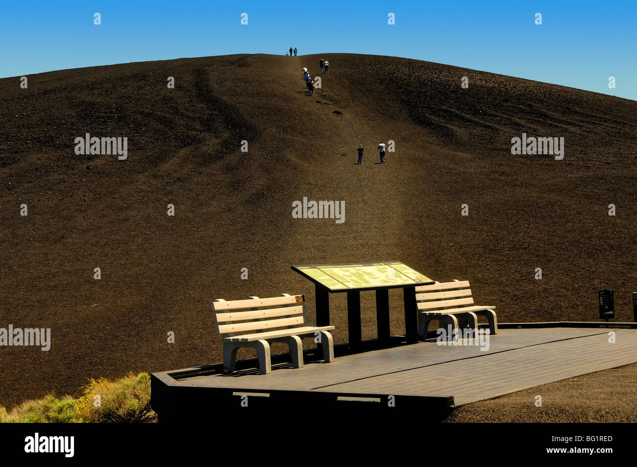 Visitors climbing up Inferno Crater, an extinct volcanic cone at Craters of the Moon National Monument in Idaho, Stock Photo