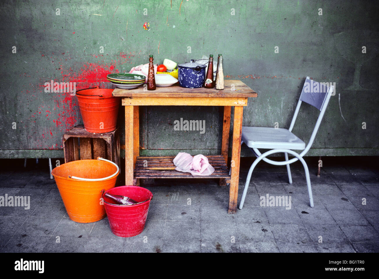 Tacos are made at this small table and dishes are washed in buckets ...