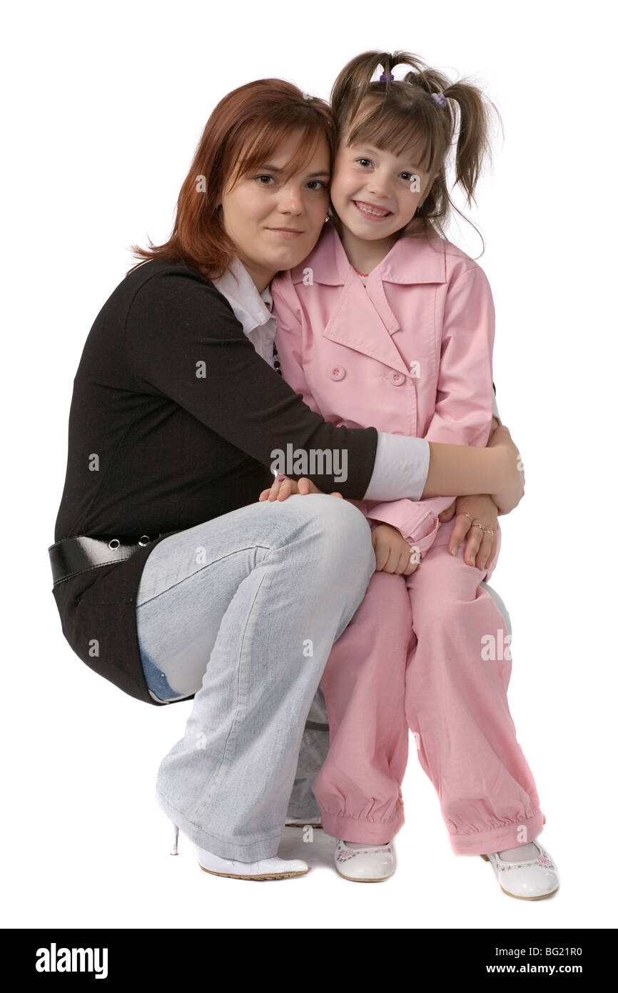 young mother embracing her little daughter isolated on white - Stock Image
