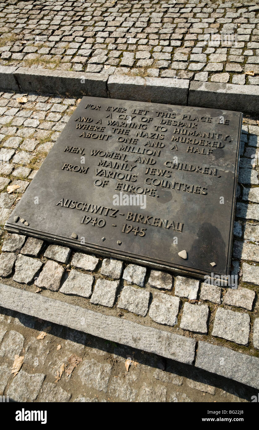 Memorial plaque dedicated to the victims of the holocaust at Birkenau (Auschwitz II ) Nazi death camp in Oswiecim, - Stock Image