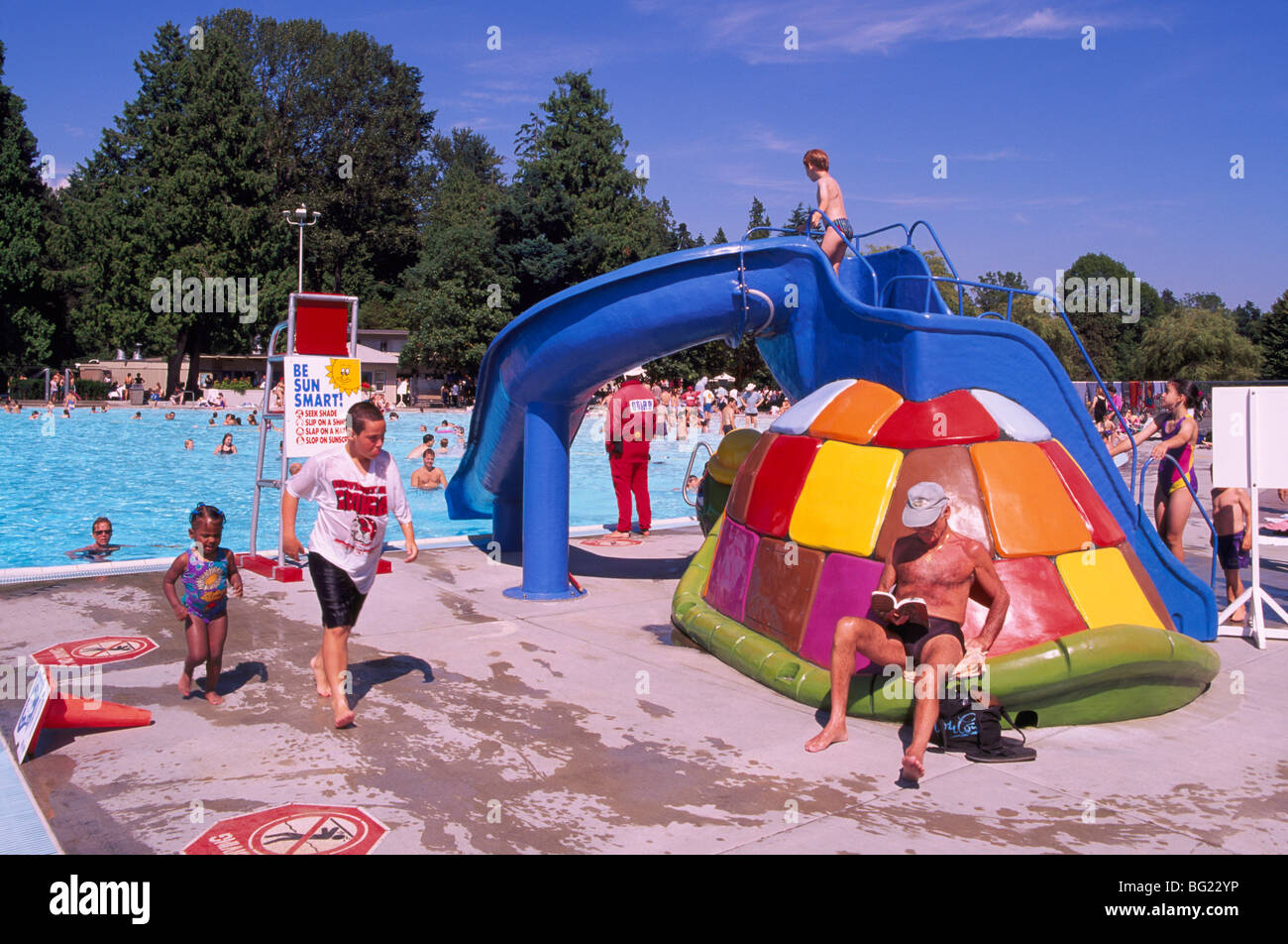Children 39 s water slide at outdoor swimming pool stanley park stock photo 27091114 alamy for Swimming pool supplies vancouver