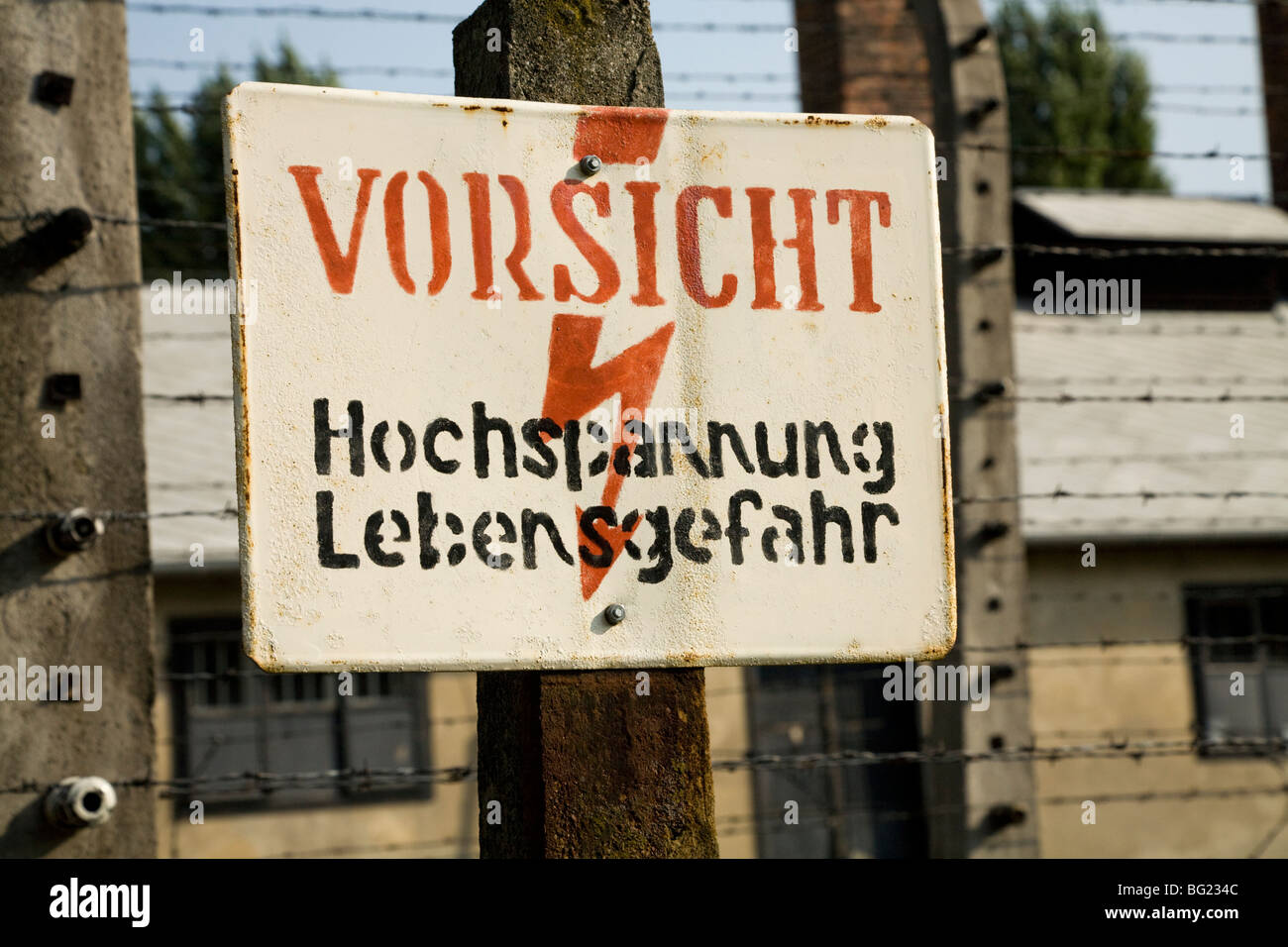 Reproduction / replica / new warning sign on the perimeter electric fence at Auschwitz Nazi death camp in Oswiecim, - Stock Image