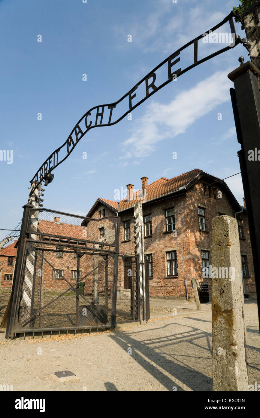 The main entrance – with REAL the Arbeit Macht Frei slogan above the gates – at Auschwitz Nazi death camp in Oswiecim, - Stock Image