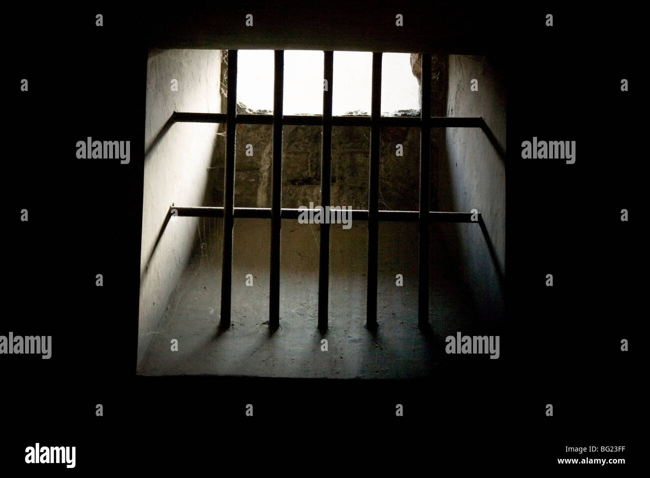 Barred prison cell window at Auschwitz Nazi death camp in Oswiecim, Poland. - Stock Image