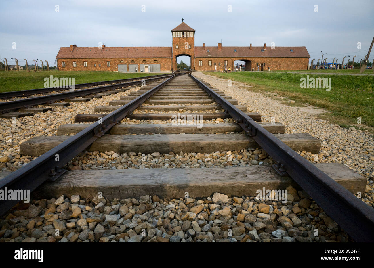 Railway lines leading inside from the main entrance at Birkenau (Auschwitz II - Birkenau) Nazi death camp in Oswiecim, - Stock Image