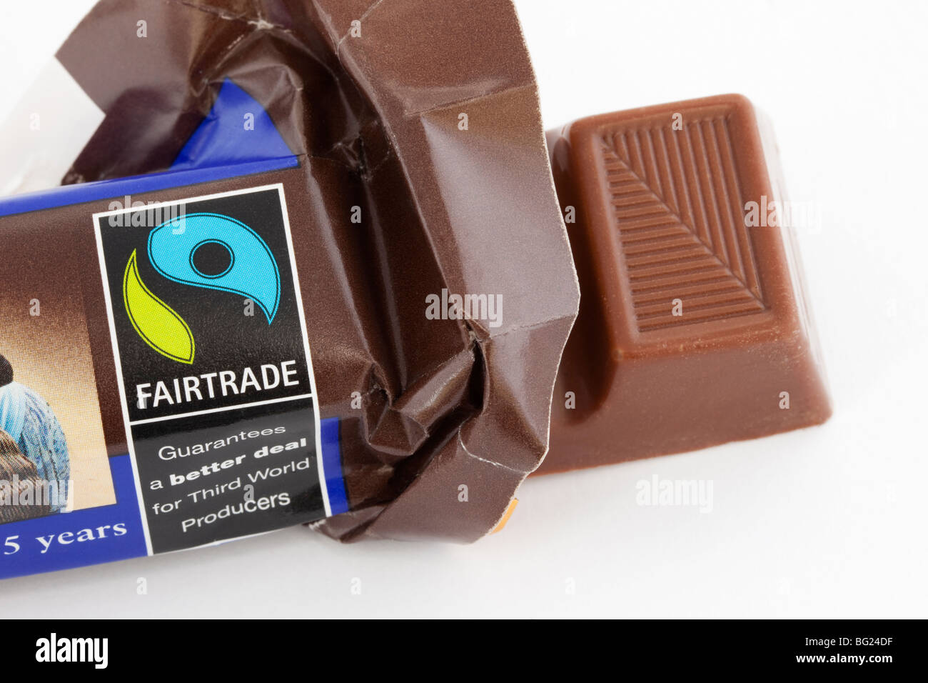 Close-up of a bar of Fairtrade chocolate unwrapped in open wrapper with fair trade logo. England UK Britain - Stock Image