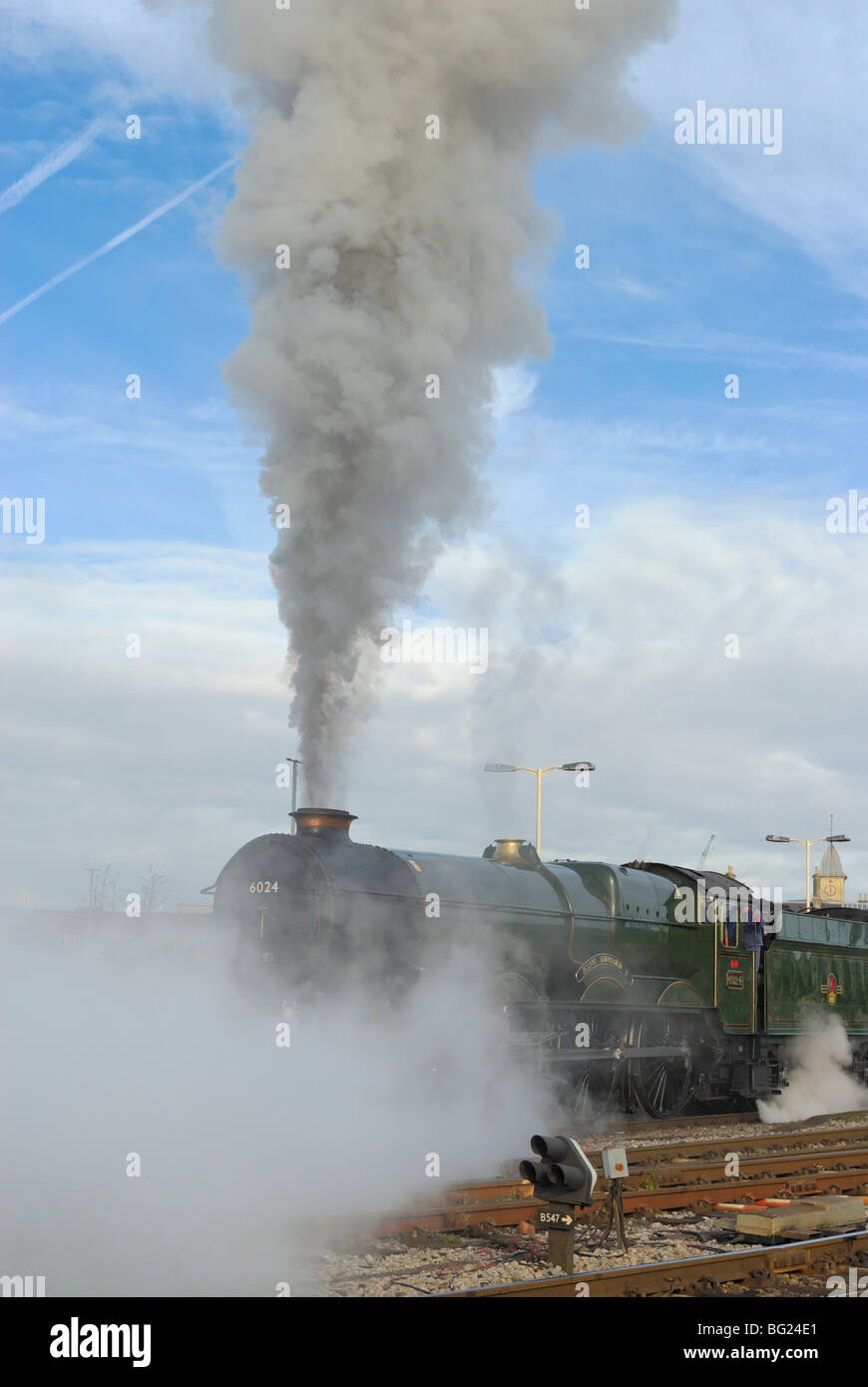 Steam locomotive standing at Temple Meads Bristol railway station ready to pull away with a steam special to Torbay Stock Photo