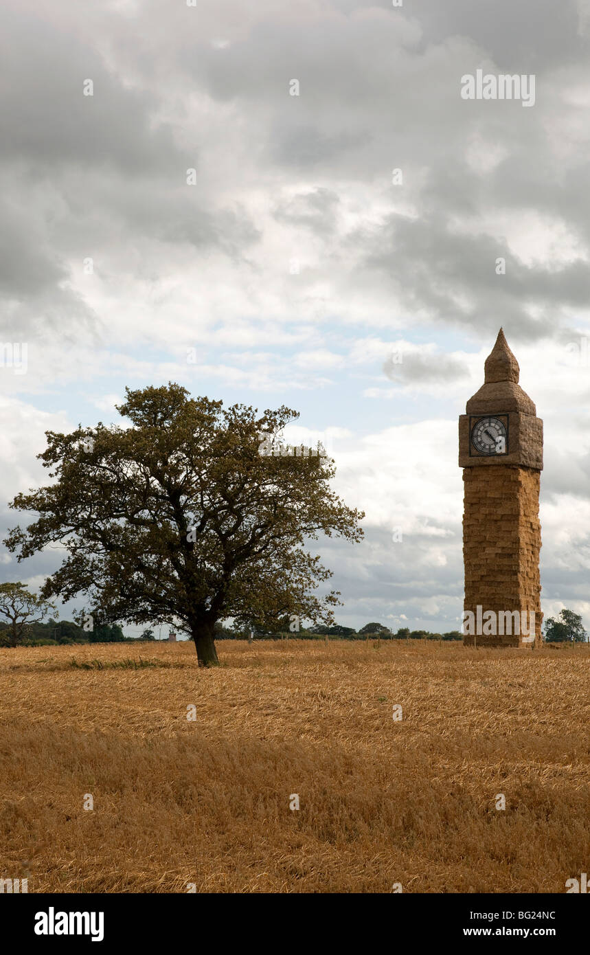 Straw Big Ben made by Sugbury Ice in a field by A51 near Nantwich Cheshire. Celebrating 150th anniversary of the - Stock Image