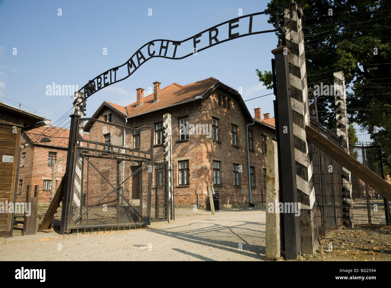 The main entrance – with REAL Arbeit Macht Frei slogan above the gates – at Auschwitz Nazi death camp in Oswiecim, - Stock Image