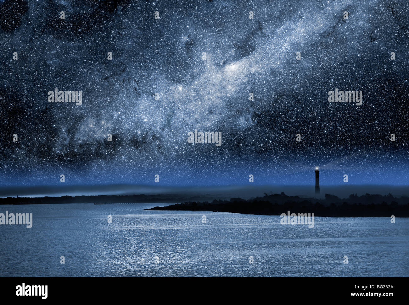 The Fire Island Light house near the western end of Fire Island at night with a bright Milky Way overhead. - Stock Image