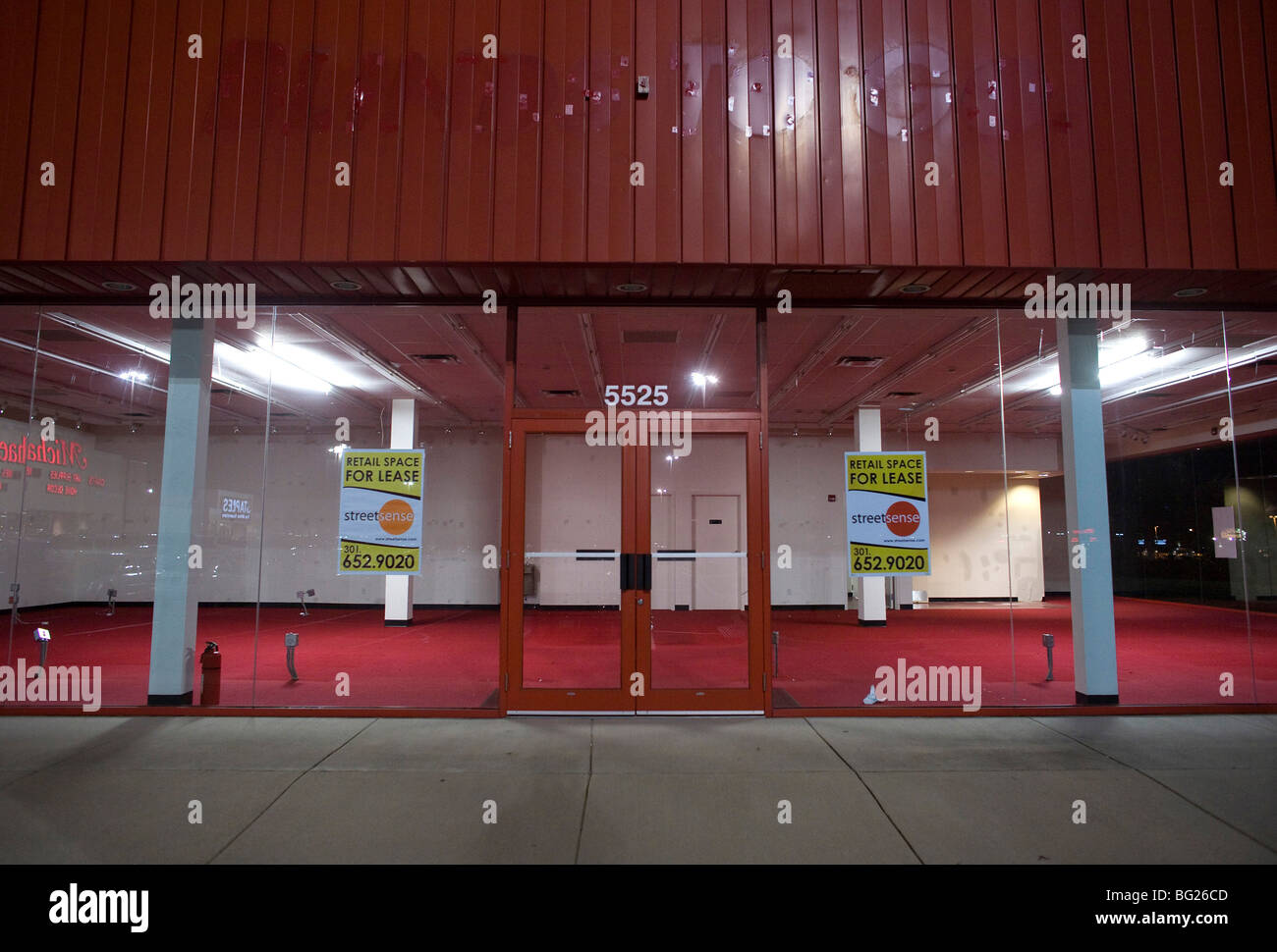 A vacant retail store front in a shopping center.  - Stock Image