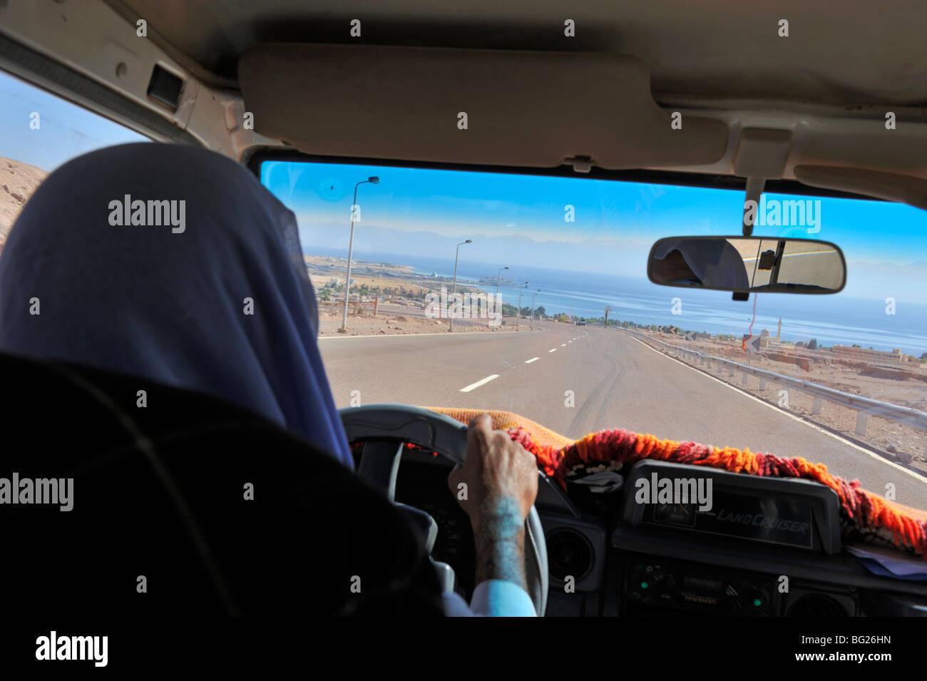 Bedouin Arab driving into Nuweiba, South Sinai peninsula, Egypt - Stock Image