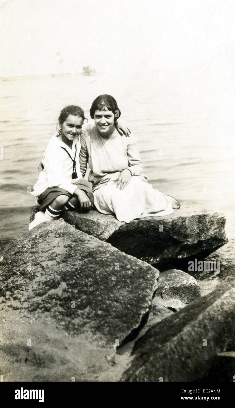 This photo of a young girl and a family friend was taken at the beach in Provincetown, Massachusetts, around 1921. - Stock Image