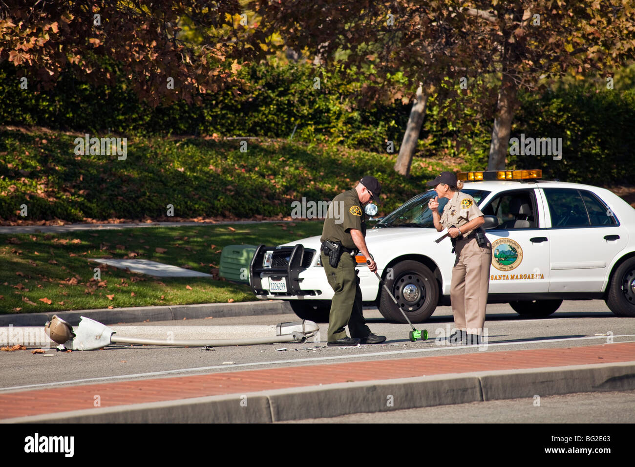 Woman driving Toyota Camry ran into lamppost & then onto an irrigation pump in Rancho Santa Margarita, CA. © - Stock Image