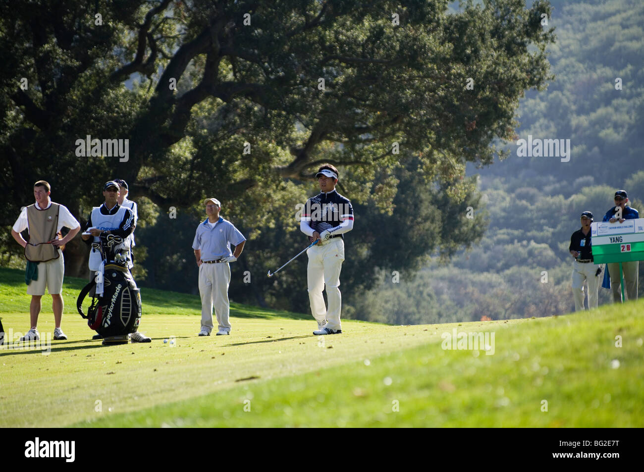 Y.E. Yang hits his approach shot to the 18t green of the Chevron World Golf Challenge at Sherwood Country Club. - Stock Image