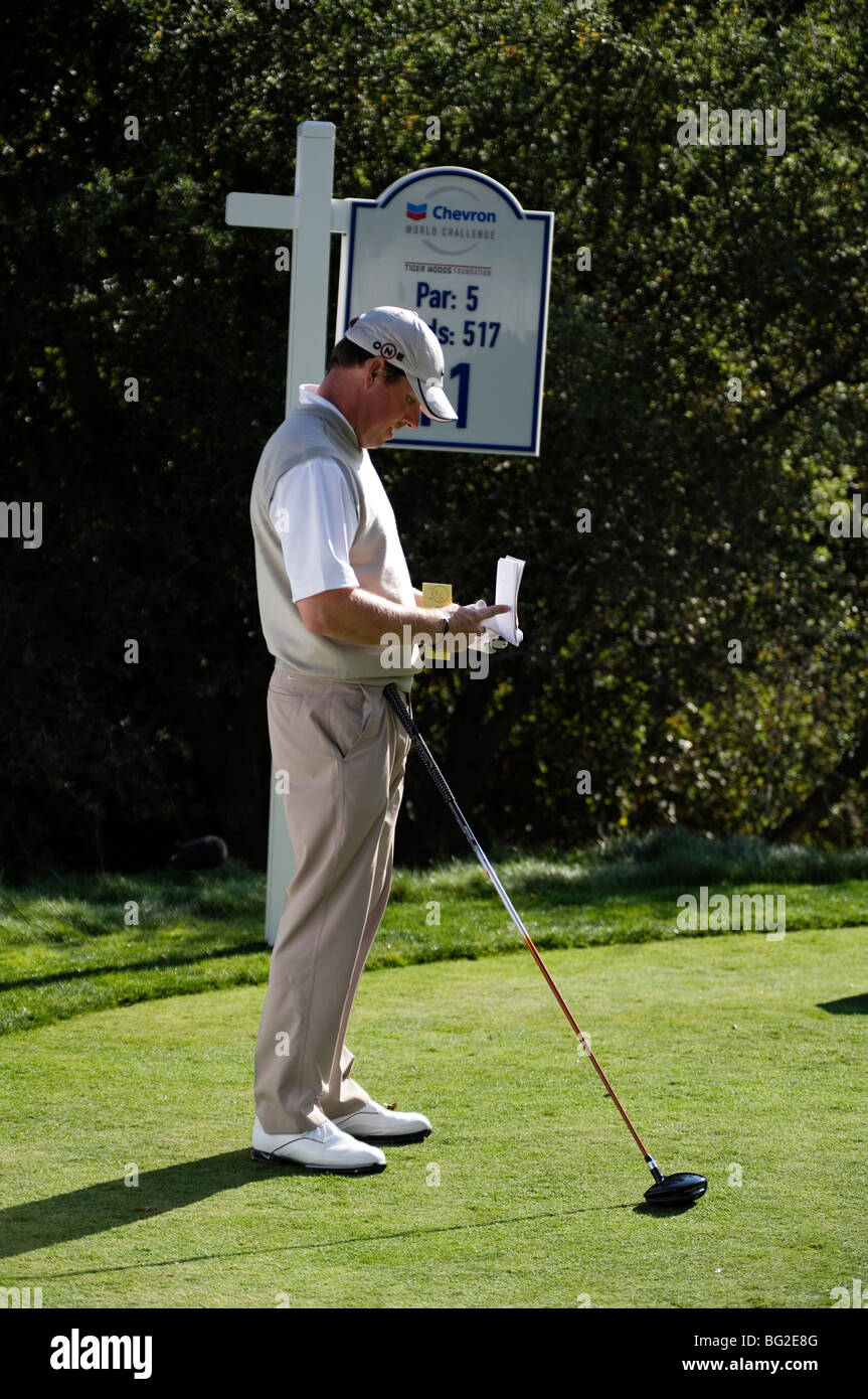 Justin Leonard consults his yardage at the par 5 11th at Sherwood Country Club during the Chevron World Golf Challenge. Stock Photo