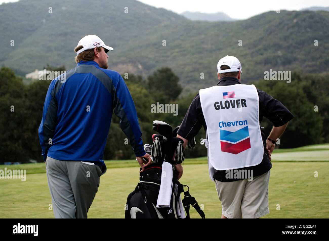 Lucas Glover stands with his caddy on the tee box during the Pro Am of the Chevron World Golf Challenge at Sherwood - Stock Image