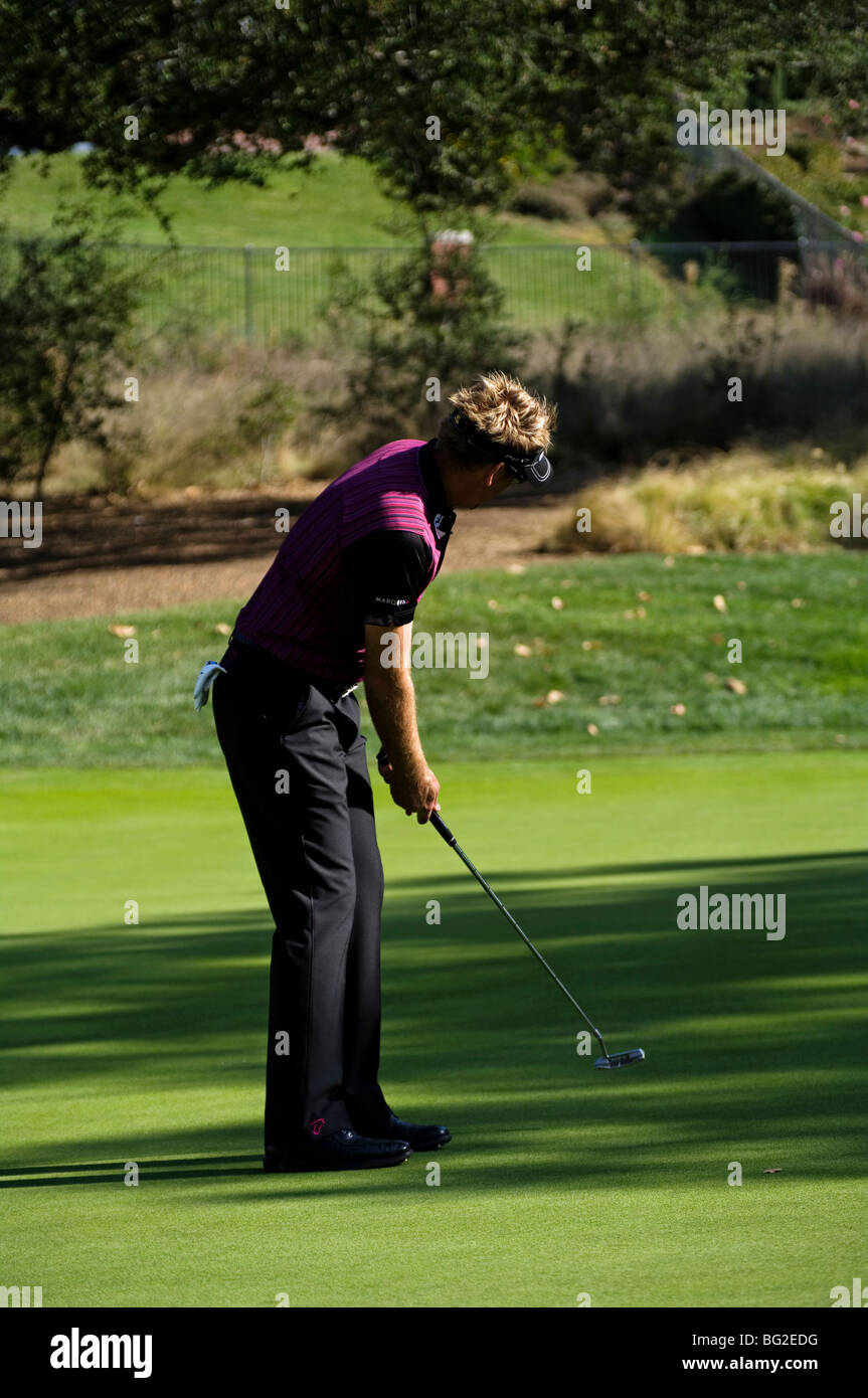 Ian Poulter putts during the Pro Am of the Chevron World Golf Challenge at Sherwood Country Club. - Stock Image