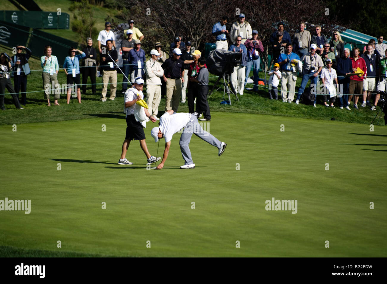 Anthony Kim marks his putt on the 18th green of Sherwood CC during the Pro Am round of the Chevron World Golf Challenge. - Stock Image