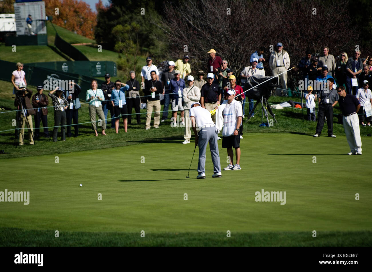Anthony Kim putts on the 18th green of Sherwood CC during the Pro Am round of the Chevron World Golf Challenge. - Stock Image