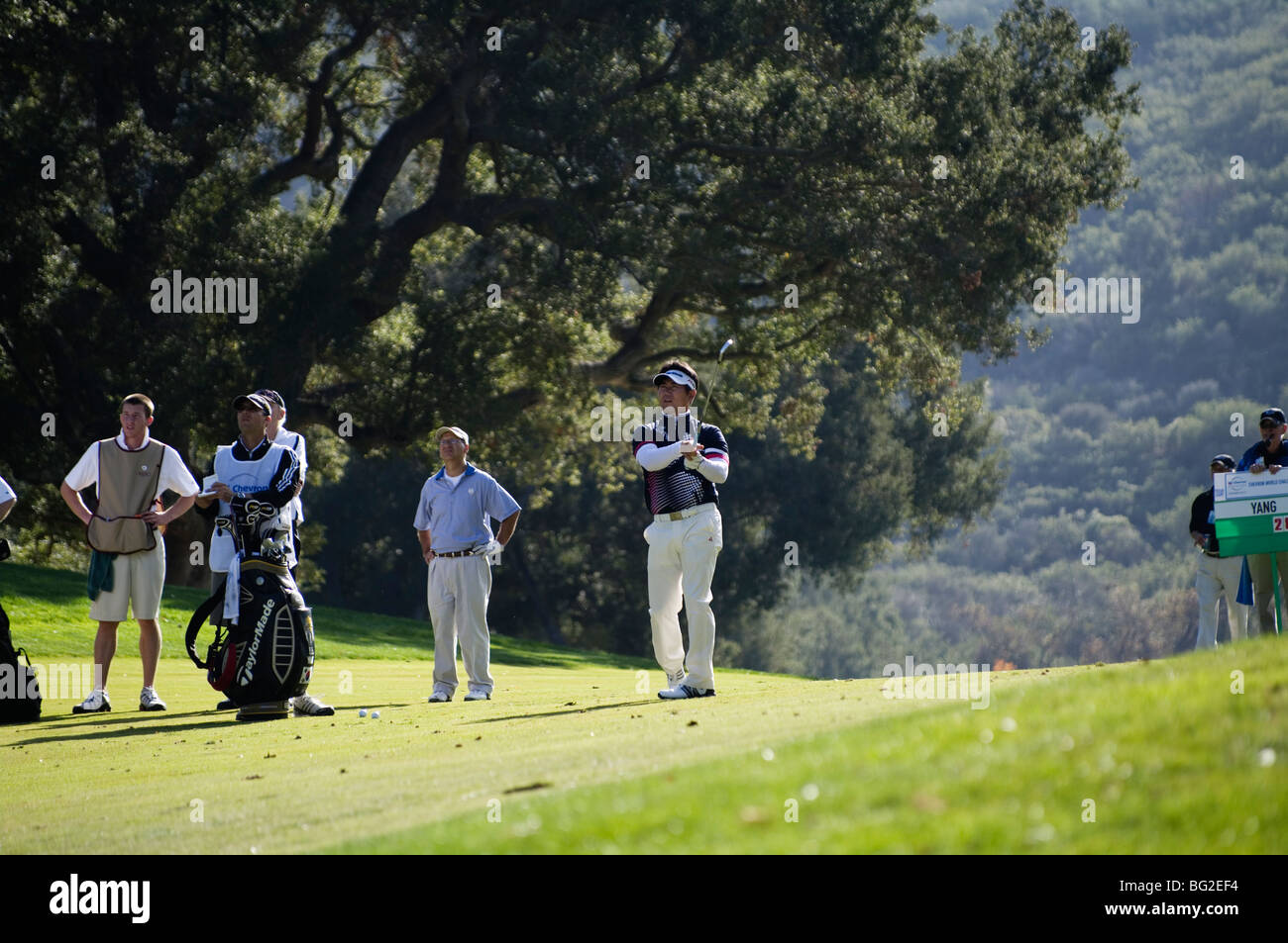 Y.E. Yang hits an approach shot to the 18th green during the Pro Am of the Chevron World Golf Challenge. - Stock Image