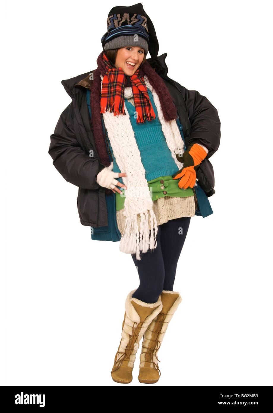 Happy young woman wearing multi-layers of clothing to keep ...
