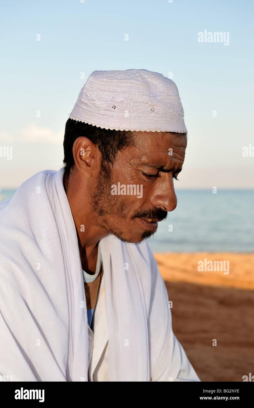 Portrait of Bedouin man in white dishdasha, Nuweiba, Egypt - Stock Image