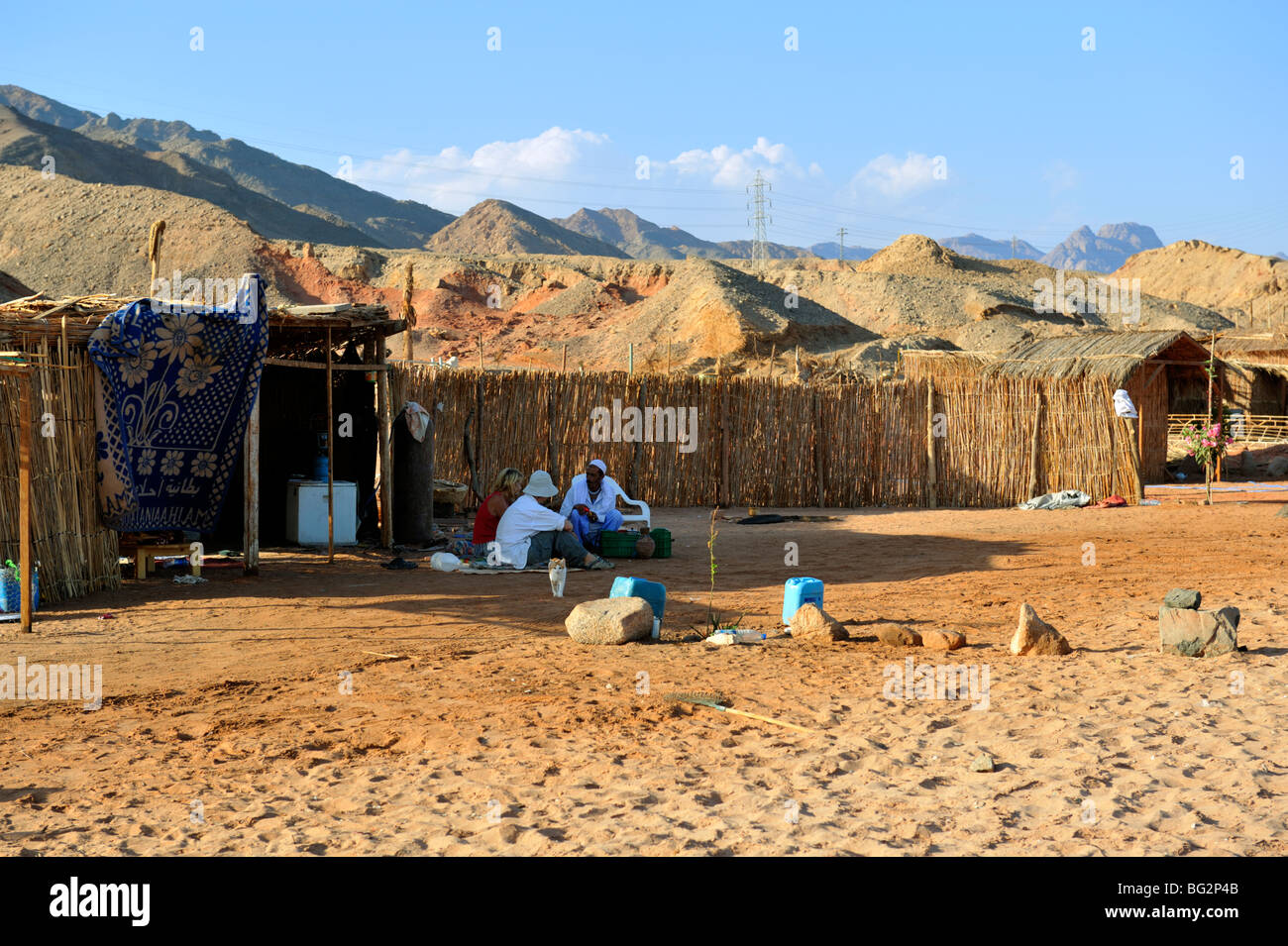 Bedouin household camp on the beach with tourist visitors, Nuweiba, Egypt - Stock Image
