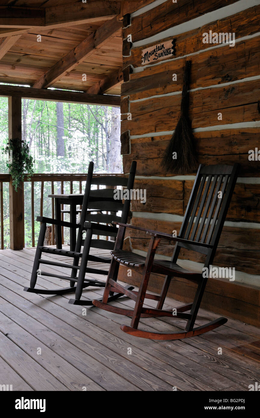 rocking chairs wooden porch of a log cabin Great Smoky Mountains National Park appalachian lifestyle - Stock Image