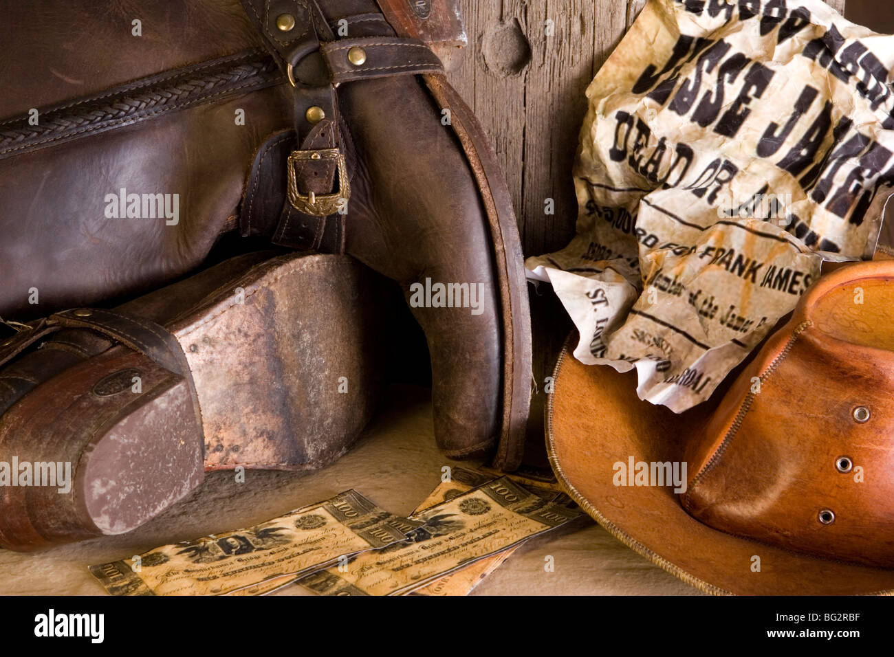 Boots and hat from wild west wanted outlaw - Stock Image