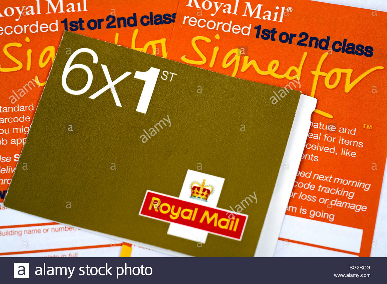 Book of UK 1st class stamps and Royal Mail recorded delivery forms - Stock Image