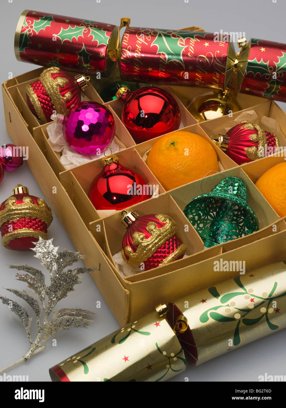 Christmas glass baubles decorations in a box with crackers and Stock ...