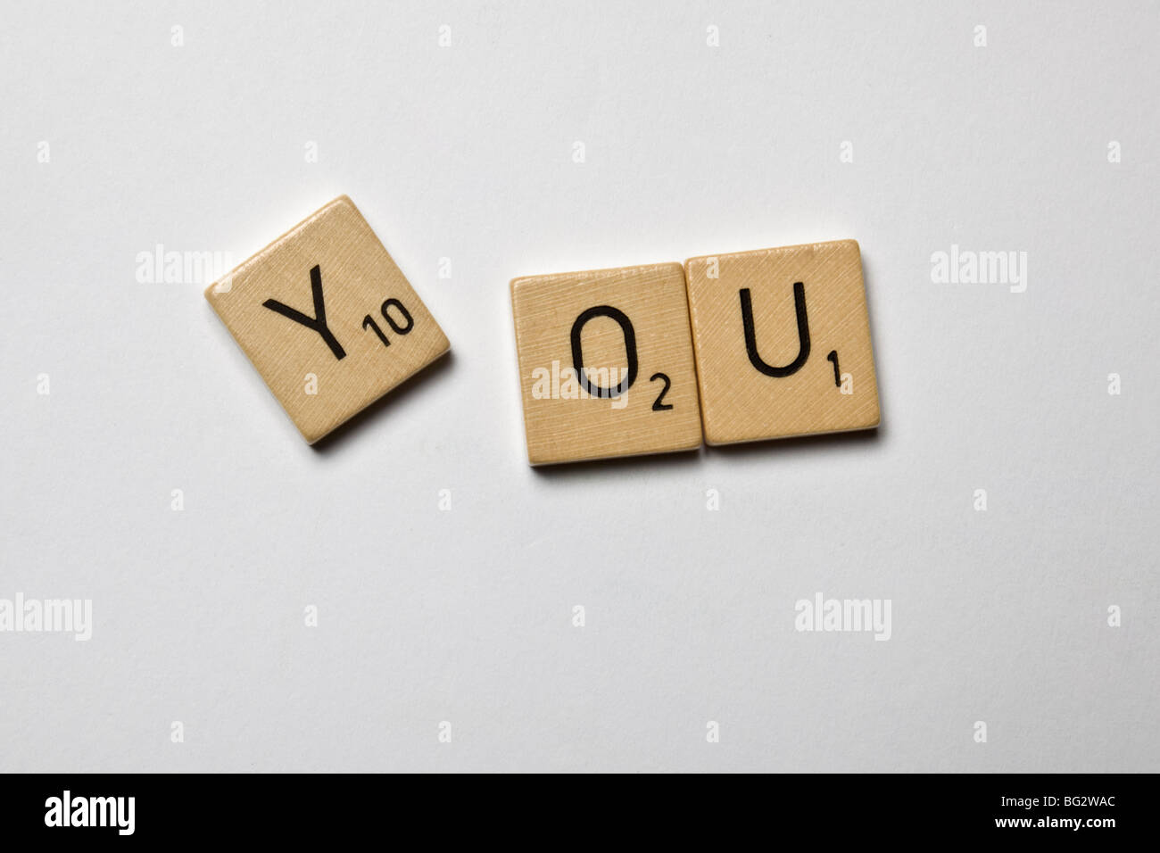 scrabble stones spelled you - Stock Image