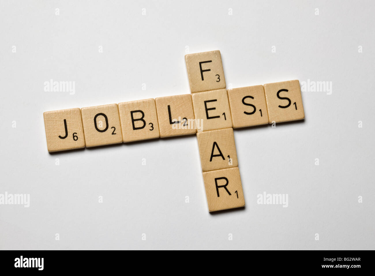 scrabble stones spelled jobless and fear - Stock Image