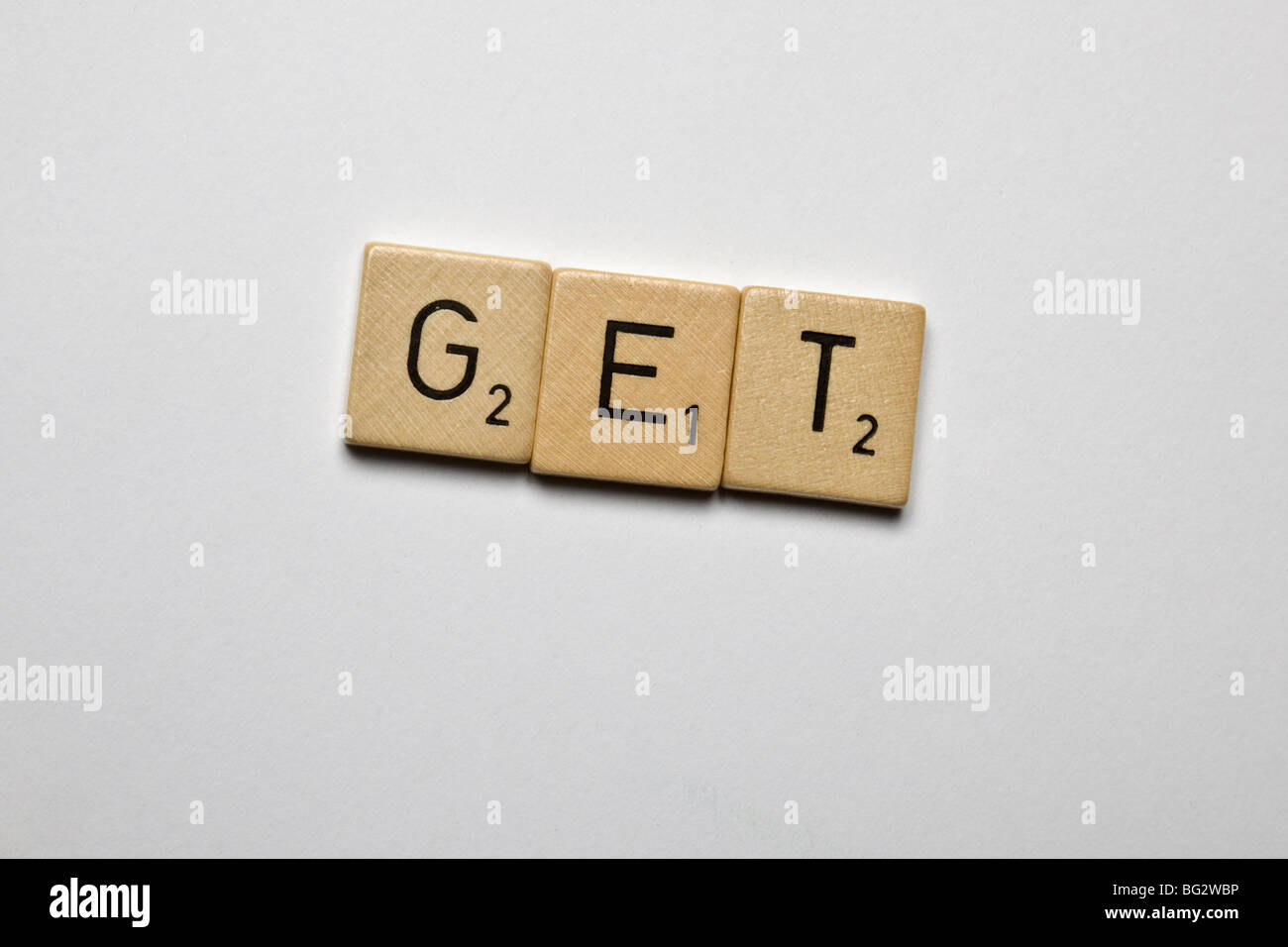scrabble stones spelled get - Stock Image