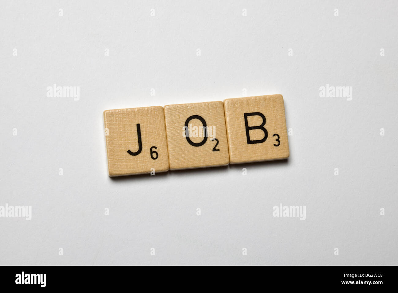 scrabble stones spelled job - Stock Image