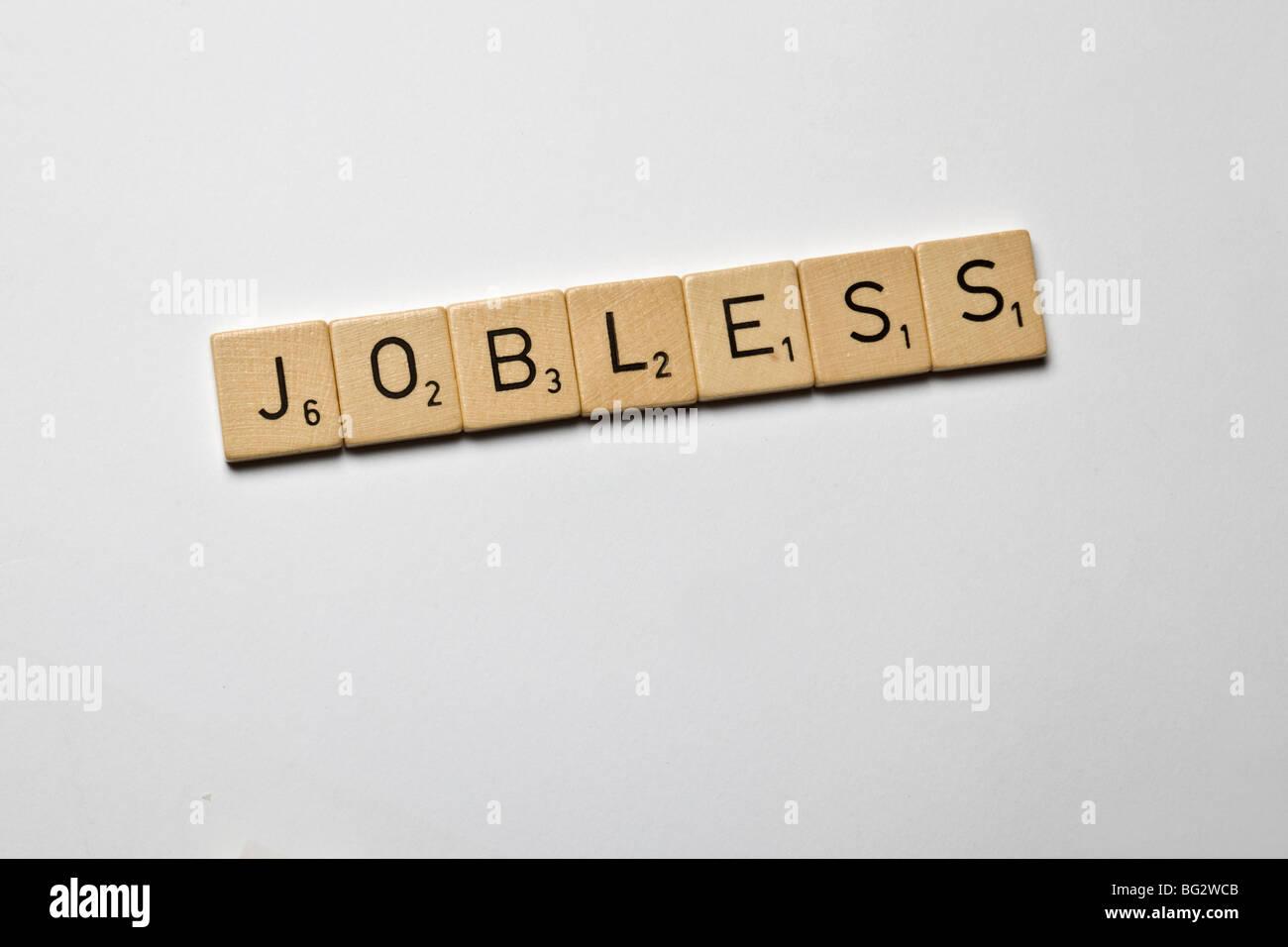 scrabble stones spelled jobless - Stock Image