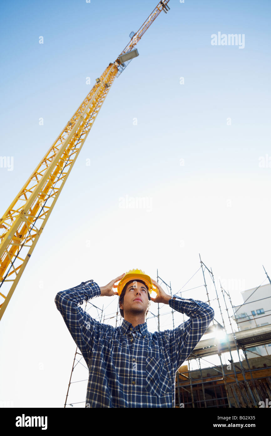 construction worker wearing hard hat. Low angle view, copy space - Stock Image