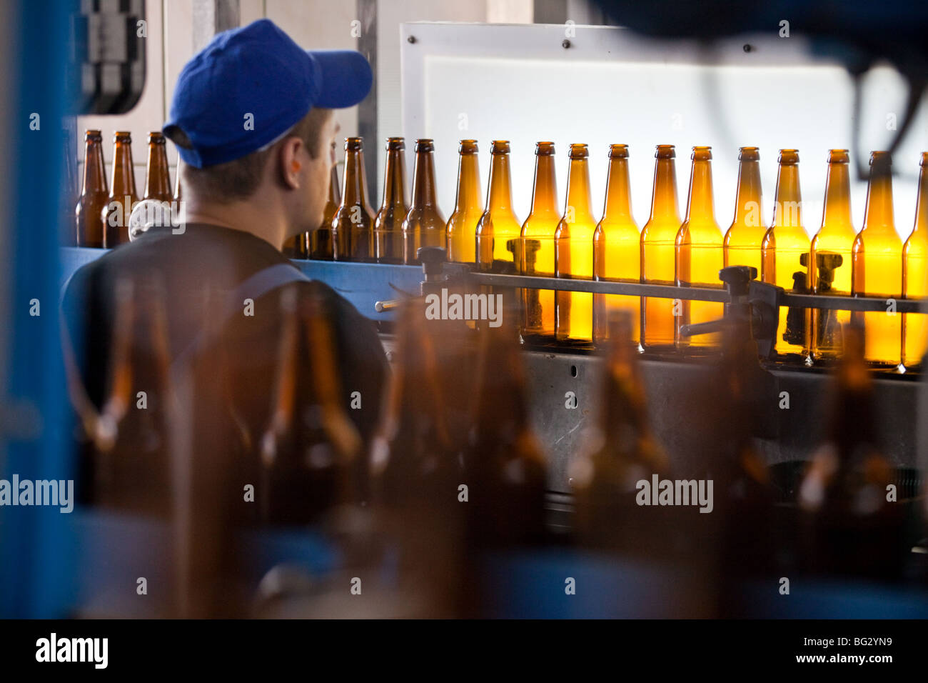 Bottles clean control in a brewery , poland - Stock Image