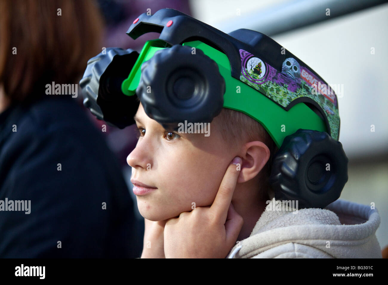 Monster Jam trucks Fan covering ears to protect himself from noise - Stock Image
