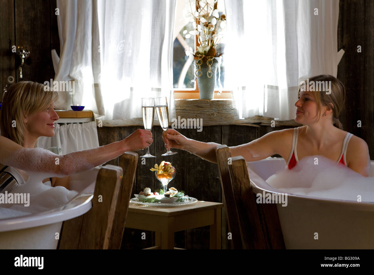 Europe, Italy, Alto Adige, Dolomiti, spa, treatments, bath, relax, wellness, sparkling wine, girls - Stock Image
