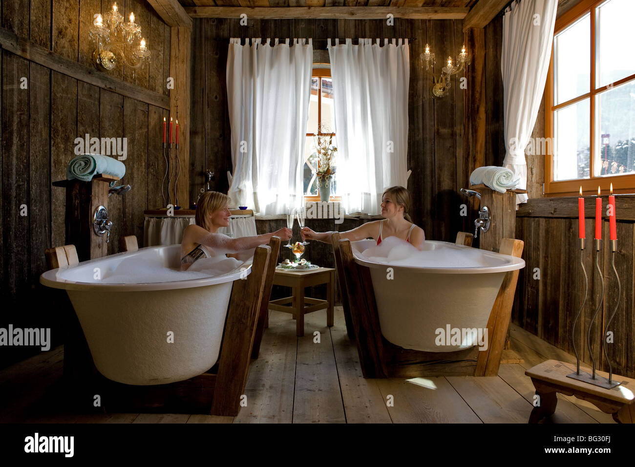 Europe, Italy, Alto Adige, Dolomiti, spa, treatments, bath, relax, wellness, girls - Stock Image