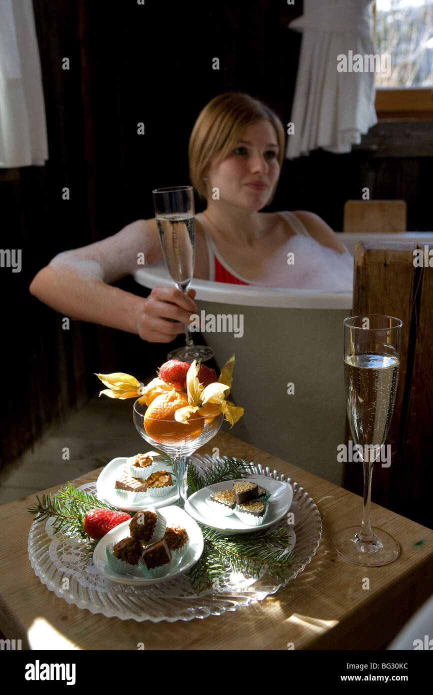 Europe, Italy, Alto Adige, Dolomiti, spa, treatments, bath, relax, wellness, food, sparkling wine, girl - Stock Image
