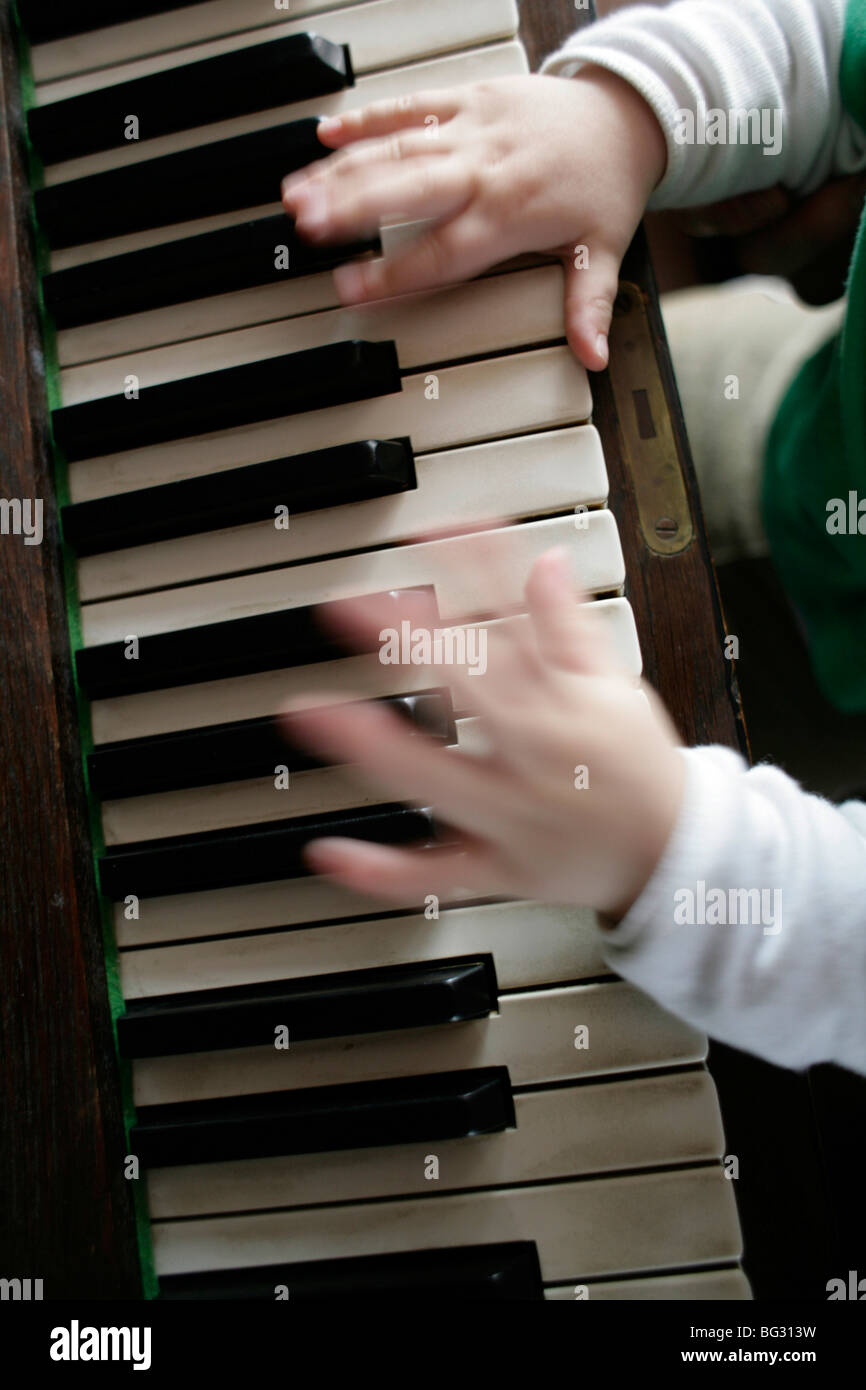 Little child playing piano . Bonn , Germany . - Stock Image