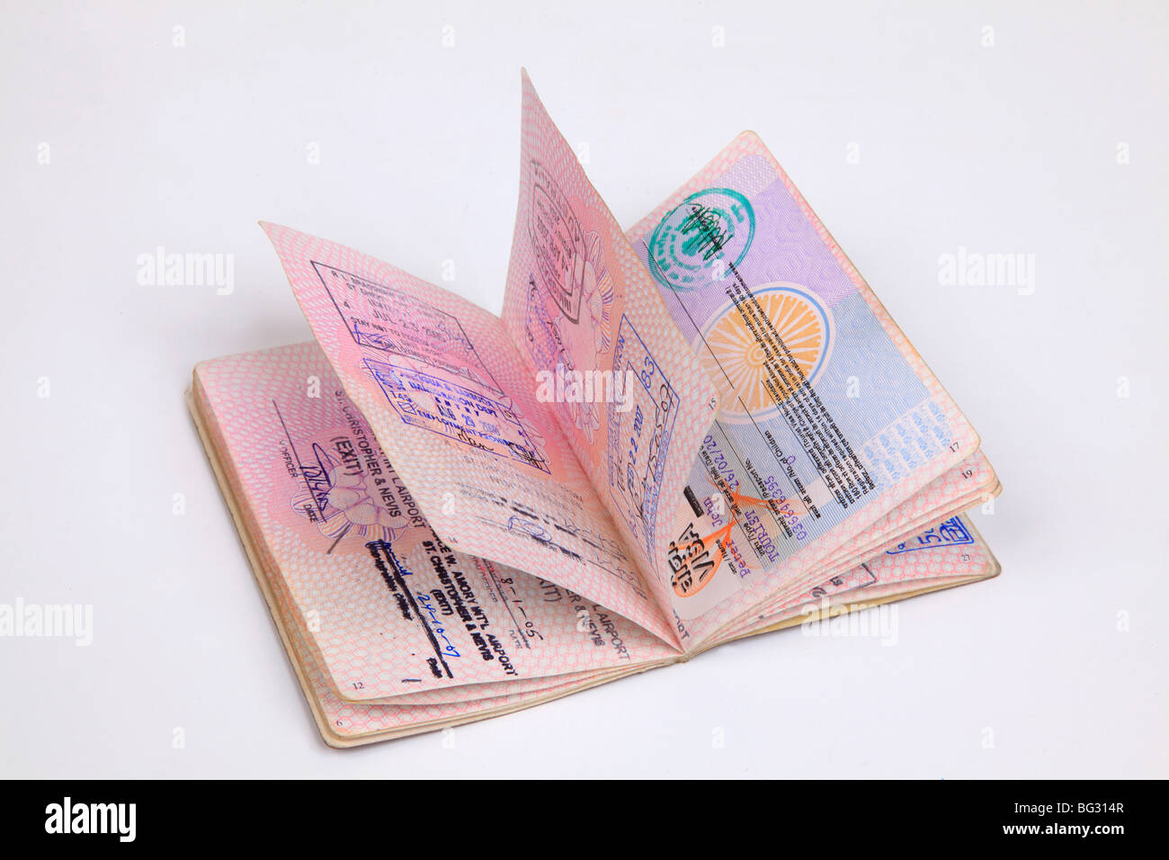 UK Passport pages with destination stamps from different countries. - Stock Image