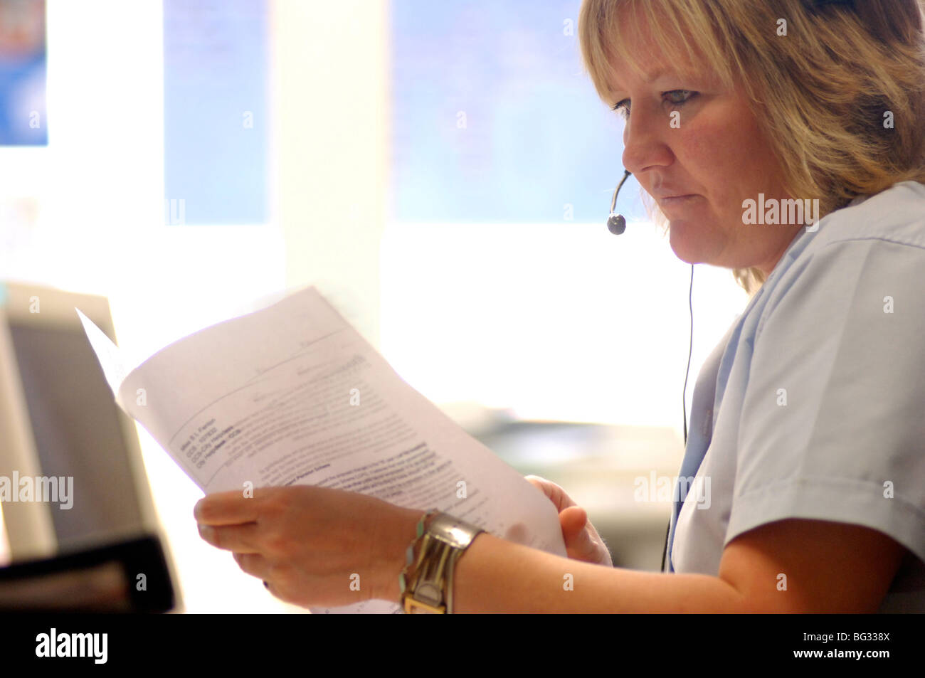 Royalty free photograph of customer support operator helping client on telephone in UK London offices. Stock Photo