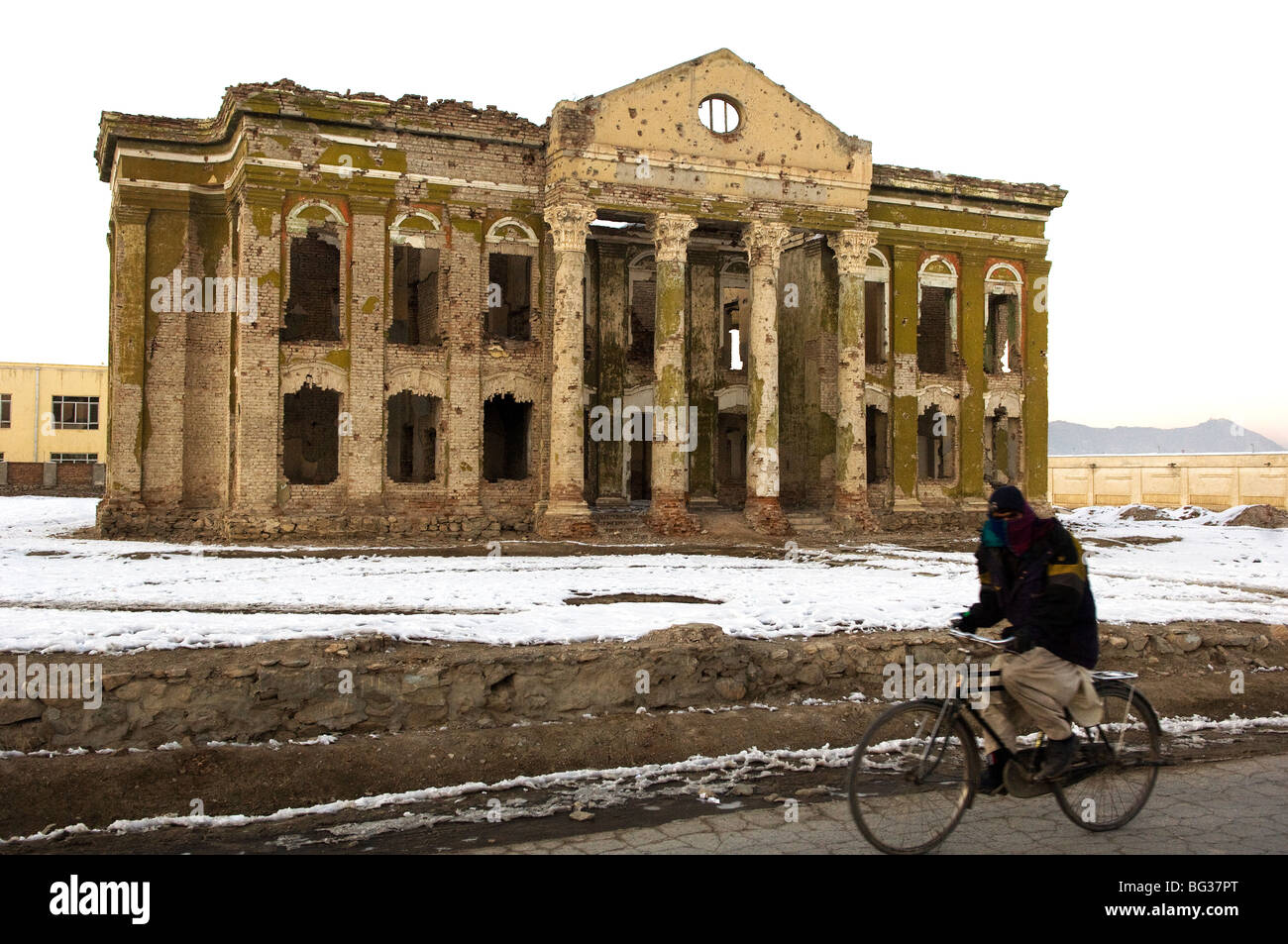 Afghan Man Cycling In The Snow Near The Darul Aman Palace Kabul