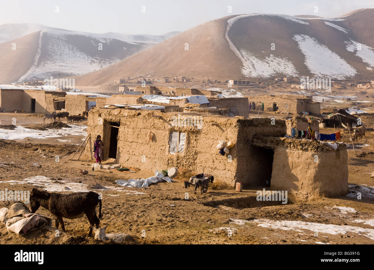 Traditional Afghan village in the mountains near Turkmenistan border in Faryab Province, Afghanistan. - Stock Image