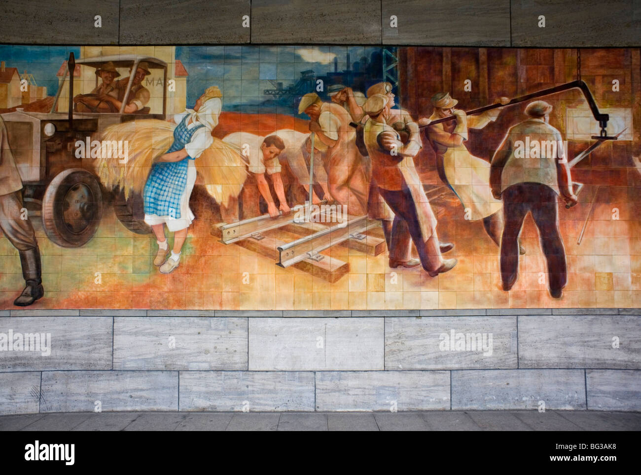 Berlin 2009 Mural Workers Socialism socialist industry soviet mass Finance peace air ministry 1989 DDR Germany Unified - Stock Image