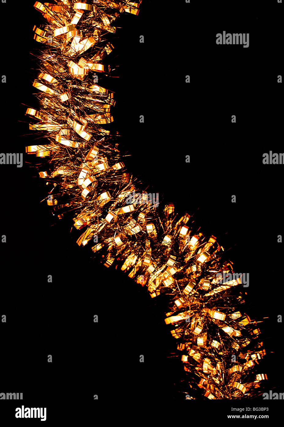 Gold colored Tinsel - Stock Image